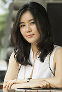 North Korean defector Hyeonseo Lee poses for a photo near the Cheonggyecheon stream in central Seoul, June 19, 2015.  Photo by Lee Jae-Won (SOUTH KOREA)  www.leejaewonpix.com