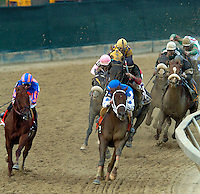 Smarty Jones with Stewart Elliot aboard takes the lead in the 129th Preakness Stakes, Baltimore, MD on May 15, 2004.  Photo: Jeff Snyder