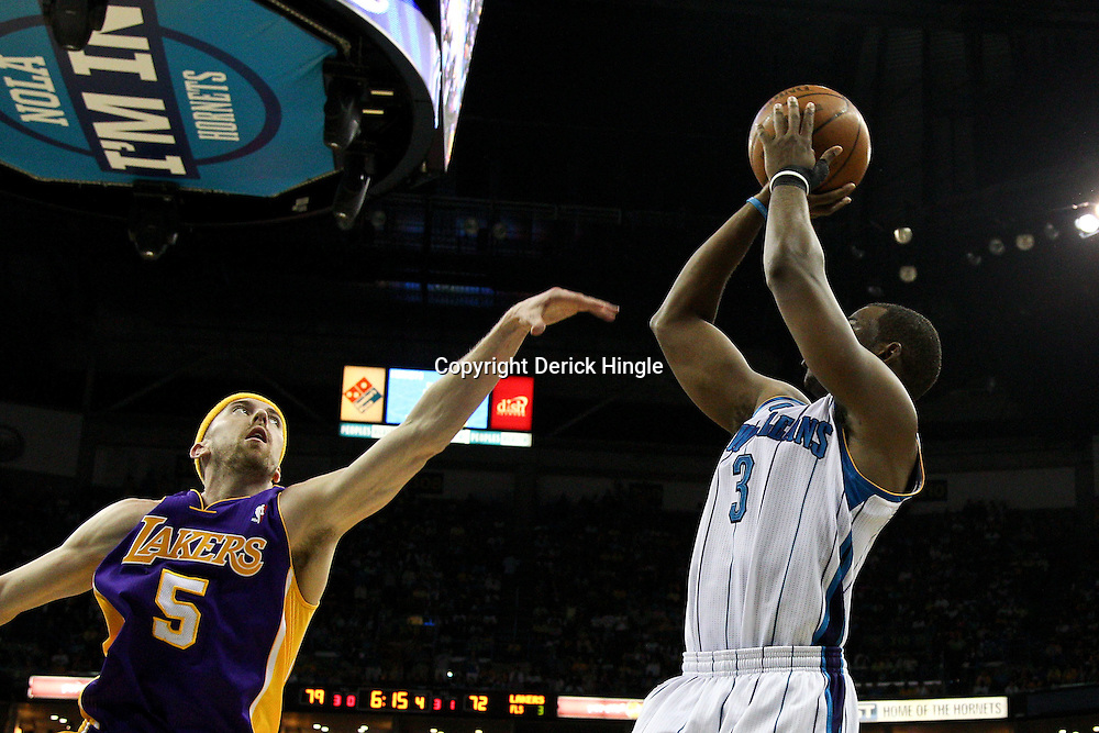 April 24, 2011; New Orleans, LA, USA; New Orleans Hornets point guard Chris Paul (3) shoots over Los Angeles Lakers point guard Steve Blake (5) during the fourth quarter in game four of the first round of the 2011 NBA playoffs at the New Orleans Arena. The Hornets defeated the Lakers 93-88.   Mandatory Credit: Derick E. Hingle
