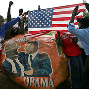 Kenyans celebrate in Western Kenyan by a rock painted with a picture of Barack Obama and Kenyan Prime Minister Raila Odinga -- both from the Luo tribe -- following the announcement that Obama had won the presidency. November 5, 2008. Photo by Evelyn Hockstein for The New York Times.