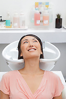 Woman getting her hair washed at beauty salon