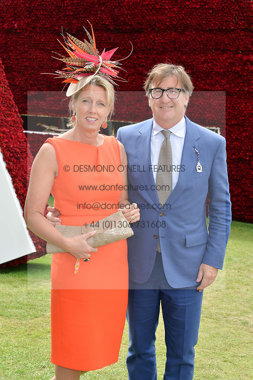 JOHN AYTON and ANNOUSHKA DUCAS at the Qatar Goodwood Festival - Ladies Day held at Goodwood Racecourse, West Sussex on 30th July 2015.