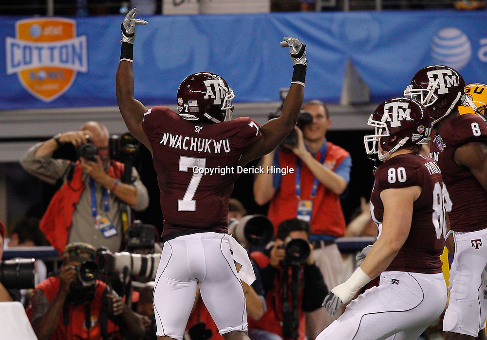 Jan 7, 2011; Arlington, TX, USA; Texas A&M Aggies wide receiver Uzoma Nwachukwu (7) celebrates with teammates following a touchdown catch during the second quarter of the 2011 Cotton Bowl against the LSU Tigers at Cowboys Stadium.  Mandatory Credit: Derick E. Hingle