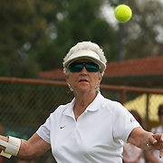 Margaret Robinson, Australia, in action against Elaine Stephan, New Zealand during the Queens Cup match during the 2009 ITF Super-Seniors World Team and Individual Championships at Perth, Western Australia, between 2-15th November, 2009..
