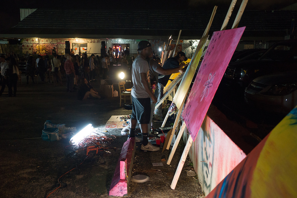 MIAMI, FLORIDA, NOVEMBER 2, 2015<br /> Artists work on pieces in the parking lot of the Wynwood Warehouse Project Gallery in the Wynwood arts district in MIami, Florida two days before the official kickoff of Art Basel 2015. (Photo by Angel Valentin/Freelance)