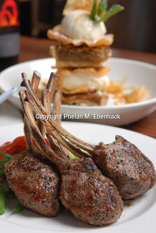 A serving of wood grilled rack of lamb accomanied by an ice cream and bourbon pecan pie tower.