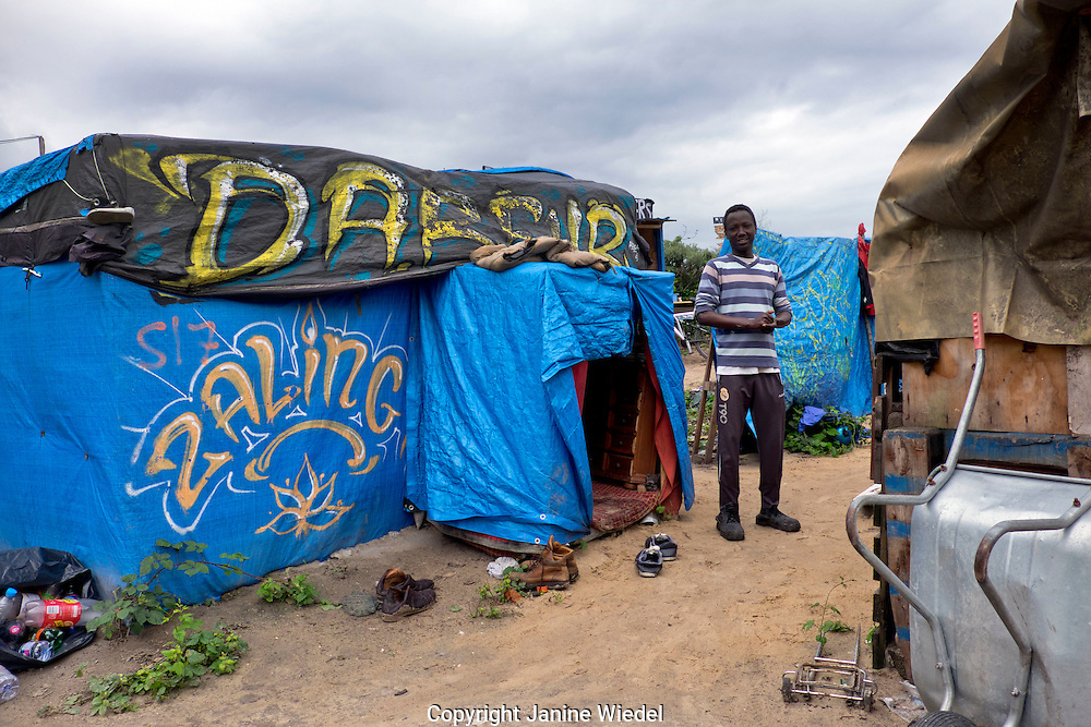 Mohamedain Adam from Darfour Sudan living 3 months in The Calais Jungle Refugee and Migrant Camp in Franceinside