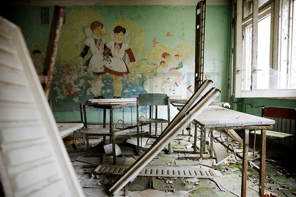 A degraded classroom, part of 1 of the 5 schools at the abandoned town of Prypiat, built less than 5 kilometers from the explosion site an whose objective was to service Chernobyl stations. Because of the high levels of radiation, all 50,000 residents were evacuated from the city the day after the disaster, not having time to gather all their personal belongings.