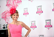 Krista Rosenberg, of Boca Raton, FL, walks the pink carpet after winning the Longines Kentucky Oaks Day Fashion Contest, Friday, May 5, 2017, in Louisville, KY. Longines, the Swiss watch manufacturer known for its luxury timepieces, is the Official Watch and Timekeeper of the 143rd annual Kentucky Derby. (Photo by Diane Bondareff/AP Images for Longines)
