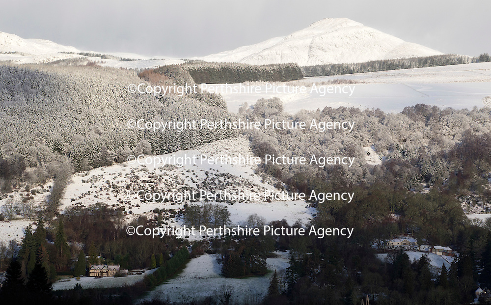 A wintry scene in Aberfeldy Perthshire this morning after overnight snow...11.12.14 as snow covers the hills surrounding the town, pictured bottom left is JK Rowlings home Killichassie House...<br /> Picture by Graeme Hart.<br /> Copyright Perthshire Picture Agency<br /> Tel: 01738 623350  Mobile: 07990 594431