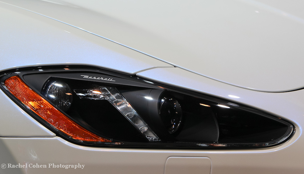 &quot;Maserati Headlight&quot;<br /> <br /> The stylish and futuristic headlight detail and logo on a 2013 Maserati!!<br /> <br /> Cars and their Details by Rachel Cohen