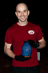 January 19, 2019 - Southern Pines, North Carolina, US - Jan. 19, 2019 - Southern Pines N.C., USA - Scott Harber, Charlotte, North Carolina, wins the men's division at the 10th Annual Weymouth Woods 100km ultra marathon at the Weymouth Woods Nature Preserve. Runners needed to complete 14 laps of the 4.47 mile course for 62.58 miles in under the 20-hour time allotment. Harber previously won this race in 2016. (Credit Image: © Timothy L. Hale/ZUMA Wire)