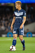 Melbourne Victory midfielder Keisuke Honda (4) prepares for a free kick at the Hyundai A-League Round 1 soccer match between Melbourne Victory and Melbourne City FC at Marvel Stadium in Melbourne.