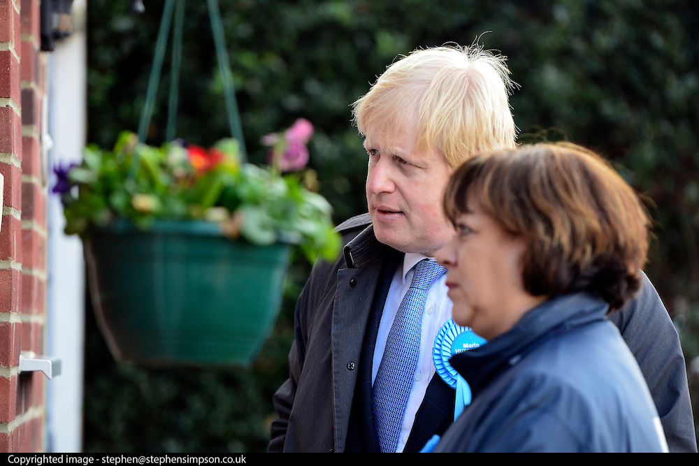 © Licensed to London News Pictures. 20/02/2013. Eastleigh, UK Boris Johnson and Maria Hutchins talk to a potential voter (unseen). London Mayor and member of the Conservative Party, Boris Johnson, and Conservative Candidate Maria Hutchins campaigning in the Eastleigh By-Election today 20th February in Stamford way, Eastleigh. Photo credit : Stephen Simpson/LNP
