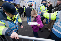 © Ben Cawthra. 28/01/2012. A young boy is searched by security as he enters Loftus road to watch QPR play Chelsea in the Barclays Premiership. Security has been heightened due to tensions between the clubs following an on field alleged racial incident. Photo credit : Ben Cawthra