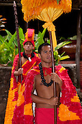 Hawaiian men reenact a ceremonial pagent of the Hawaiian royalty