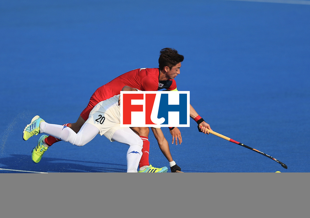LONDON, ENGLAND - JUNE 19:  Azuan Hasan of Malaysia and Manjae Jung of South Korea battle for possesion during the Pool A match between South Korea and Malaysia on day five of Hero Hockey World League Semi-Final at Lee Valley Hockey and Tennis Centre on June 19, 2017 in London, England.  (Photo by Alex Morton/Getty Images)