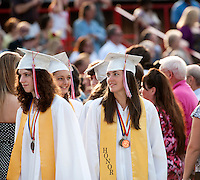 Graduates Brooke Baerman, Amy Cass and Emily Compton lead the processional onto the football field for the 133rd Commencement Exercise at Laconia High School Friday evening.  (Karen Bobotas/for the Laconia Daily Sun)