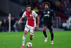 13-08-2019 NED: UEFA Champions League AFC Ajax - Paok Saloniki, Amsterdam<br />  Ajax won 3-2 and they will meet APOEL in the battle for a group stage spot / Noussair Mazraoui #12 of Ajax, Diego Biseswar #21 of PAOK
