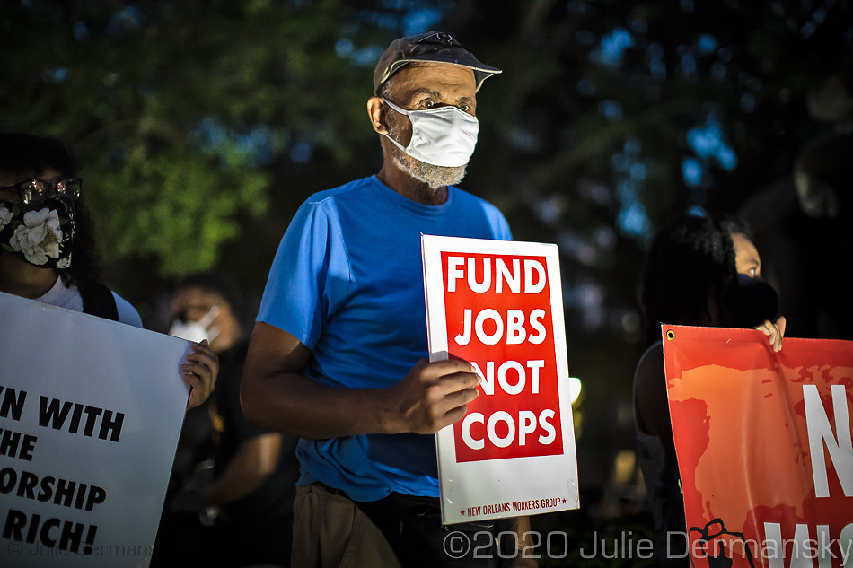 A man with an anti police sign at a Take 'Em Down NOLA  rally and march held on June 27, 2020 . The organizers warned the city it had three days left to take down white supremacist monuments now being referred to as monuments to white mediocrity,  or else the monuments will come down by unauthorized means- A few hundred people came out to protest against police violence and racial inequality and marched through the French Quarter stopping at monuments on the groups list that it demands be taken down. The organizers explained the historical significance of each statue.
