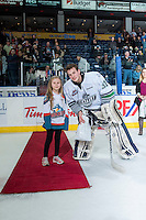 KELOWNA, CANADA - MARCH 18: Logan Flodell #31 of Seattle Thunderbirds accepts a star of the game Kelowna Rockets on March 18, 2015 at Prospera Place in Kelowna, British Columbia, Canada.  (Photo by Marissa Baecker/Shoot the Breeze)  *** Local Caption *** Logan Flodell;