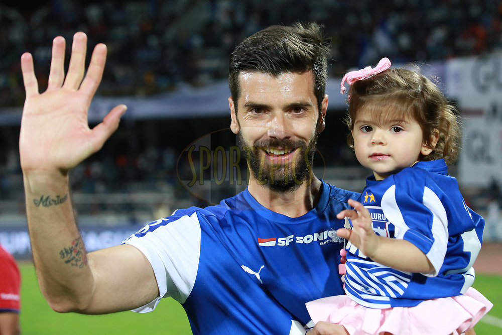 Daniel Segovia of Bengaluru FC  with his daughter after winning the first semi final 2nd leg of the Hero Indian Super League between Bengaluru FC and FC Pune City  held at the Sree Kanteerava Stadium, Bengaluru, India on the 11th March 2018 <br /> <br /> Photo by: Faheem Hussain / ISL / SPORTZPICS