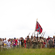 Visitors and living historians gathered to participate in the Pickett's Charge Commemorative March, during the Sesquicentennial Anniversary of the Battle of Gettysburg, Pennsylvania on Wednesday, July 3, 2013.  The march was an opportunity to follow in the footsteps of Confederate soldiers by walking with living historians and park rangers along the path of the famously ill-fated Pickett's Charge, which brought to a close The Battle of Gettysburg when the Union Army repelled their advance. The Battle of Gettysburg lasted from July 1-3, 1863 resulting in over 50,000 soldiers killed, wounded or missing.  John Boal Photography