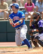 Jayhawk Preston Land drives a hit to center field against Kansas State.  The Wildcats held on to beat Kansas 5-4 at Tointon Stadium in Manhattan, Kansas, April 23, 2006.