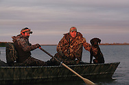 Rowing a duck boat during a Manitoba waterfowl hunt.