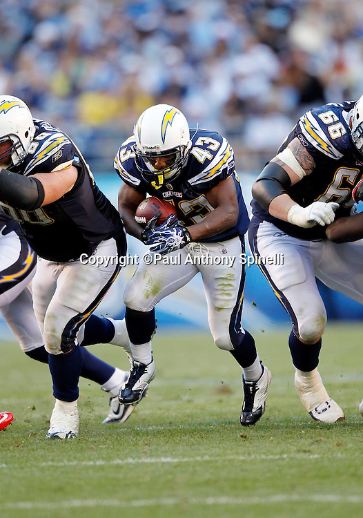 San Diego Chargers running back Darren Sproles (43) runs the ball through a blocking wall set up by San Diego Chargers guard Kris Dielman (68) and San Diego Chargers offensive tackle Jeromey Clary (66) during the NFL week 14 football game against the Kansas City Chiefs on Sunday, December 12, 2010 in San Diego, California. The Chargers won the game 31-0. (©Paul Anthony Spinelli)