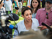 03 JULY 2019 - WEST DES MOINES, IOWA: US Senator KAMALA HARRIS (D-CA) talks to reporters in the press gaggle at the West Des Moines Democrats' annual 4th of July Picnic. Senator Harris attended the picnic to support her bid to be the Democratic nominee for the US presidency in 2020. Iowa hosts the first presidential selection event of the 2020 election cycle. The Iowa Caucuses are scheduled for Feb. 3, 2020.        PHOTO BY JACK KURTZ
