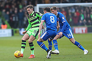 Forest Green Rovers Charlie Cooper(15) under pressure from Carlisle United's Mike Jones(8) during the EFL Sky Bet League 2 match between Forest Green Rovers and Carlisle United at the New Lawn, Forest Green, United Kingdom on 23 December 2017. Photo by Shane Healey.
