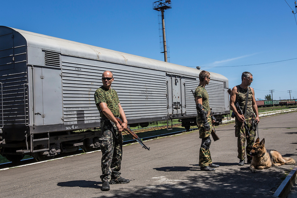 TOREZ, UKRAINE - JULY 21: Pro-Russia rebels guards a train containing the bodies of victims of the Malaysia Airlines flight MH 17 crash on July 21, 2014 in Torez, Ukraine. Malaysia Airlines flight MH17 was travelling from Amsterdam to Kuala Lumpur when it crashed killing all 298 on board including 80 children. The aircraft was allegedly shot down by a missile and investigations continue over the perpetrators of the attack. (Photo by Brendan Hoffman/Getty Images) *** Local Caption ***