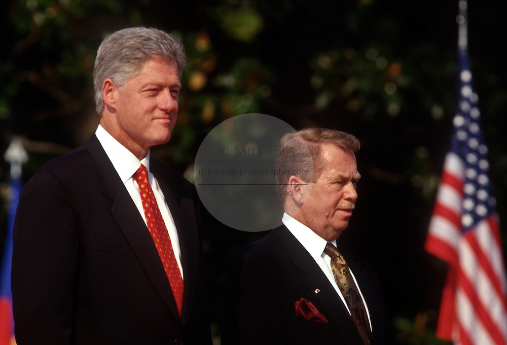 """President Bill Clinton and Czech President Vaclav Havel stand for the national anthems at the White House during the Czech State Visit September 16, 1998 in Washington, DC.  Vaclav Havel, the former dissident playwright who led Czechoslovakia's 1989 """"Velvet Revolution"""" against communism and then served as his country's president, died December 18, 2011.  He was 75."""