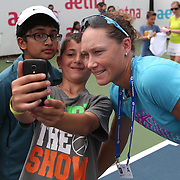 August 16, 2014, New Haven, CT:<br /> Sam Stosur poses for a selfie photograph with fans during a tennis clinic in the AETNA FitZone as part of Kids Day on day three of the 2014 Connecticut Open at the Yale University Tennis Center in New Haven, Connecticut Sunday, August 17, 2014.<br /> (Photo by Billie Weiss/Connecticut Open)