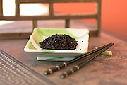 Organic Heirloom Forbidden Black Rice on a green leaf Japanese ceramic plate with ebony chopsticks
