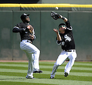 CHICAGO - APRIL 24:  Blake Tekotte #18 avoids colliding with Alejandro De Axa #30 of the Chicago White Sox while catching a fly ball against the Cleveland Indians on April 24, 2013 at U.S. Cellular Field in Chicago, Illinois.  The White Sox defeated the Indians 3-2.  (Photo by Ron Vesely)   Subject: Blake Tekotte; Alejandro De Aza