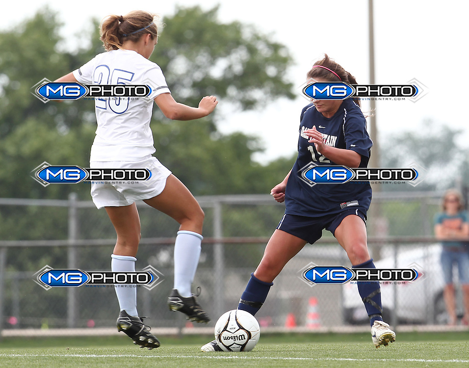 May 12, 2012; Huntsville, AL, USA;  Oak Mountain's Julianne Jackson (12) controls the ball away from Auburn's Rachel Hardgrave (25). Mandatory Credit: Marvin Gentry