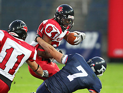 09.07.2011, UPC Arena, Graz, AUT, American Football WM 2011, Group B, France (FRA) vs Canada (CAN), im Bild Aurélien Fourgeaud (France, #7, DB ) catches Shamawd Chambers (Canada, #84, R)  // during the American Football World Championship 2011 Group B game, France vs Canada, at UPC Arena, Graz, 2011-07-09, EXPA Pictures © 2011, PhotoCredit: EXPA/ T. Haumer