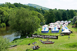 © Licensed to London News Pictures. 29/05/2016. Hay-on-Wye, Powys, Wales, UK. One of the festival sites is on the banks of the river Wye. Beautiful weather on the fourth day of the 'HowTheLightGetsIn' Festival of Ideas at Hay-on-Wye, Wales. Photo credit: Graham M. Lawrence/LNP
