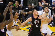 LA Clippers forward Blake Griffin (32) and Golden State Warriors center Zaza Pachulia (27) battle for a rebound during a free throw attempt at Oracle Arena in Oakland, Calif., on February 23, 2017. (Stan Olszewski/Special to S.F. Examiner)