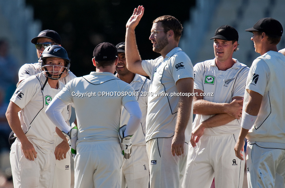 BJ Watling, left, and team celebrate after his catch out of Simon Katich, off the bowling of Daniel Vettori during day one of the 2nd cricket test match between NZ Black Caps and Australia, at Seddon Park, Hamilton, 27 March 2010. Photo: Stephen Barker/PHOTOSPORT