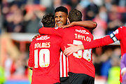 Exeter City's Ollie Watkins celebrates the home teams 2-1 win with Exeter City's Lee Holmes and Exeter City's Jake Taylor after the final whistle in the Sky Bet League 2 match between Exeter City and Plymouth Argyle at St James' Park, Exeter, England on 2 April 2016. Photo by Graham Hunt.