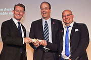 Greg Barker MP presents Lindsay Todd and Paul Ciniglio of Radian Housing Association with the UK Gold Award