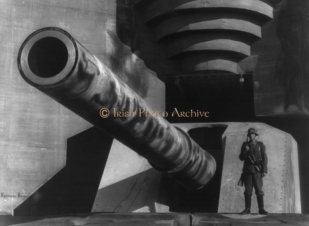 World War II 1939-1945. Barrel of a large gun with German soldier at fortifications, 1943. Weapon Armament  Heavy Artillery Guard Rifle