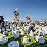 Nederland, Amsterdam, 4 mei 2016.<br /> Fab-city, expositie van allerlei duurzame initiatieven.<br /> Op de foto: Op de betonnen pilaren staan de namen van duurzame bedrijven die meedoen aan Fab-city.<br /> <br /> FabCity is een tijdelijke, gratis toegankelijke campus op de Kop van Java-eiland in het oostelijk havengebied van Amsterdam en bestaat uit zo'n vijftig innovatieve paviljoens, installaties en prototypes. Meer dan vierhonderd jonge studenten, professionals, kunstenaars en creatieven ontwikkelen de plek tot een duurzaam stedelijk gebied, waar ze werken, creëren, onderzoeken en hun oplossingen voor stedelijke vraagstukken presenteren. De deelnemers komen van verschillende onderwijsachtergronden, zoals kunstacademies, (technische) universiteiten en het beroepsonderwijs.<br /> <br /> FabCity is a temporary and freely accessible campus open between 1 April until 26 June at the head of Amsterdam's Java Island in the city's Eastern Harbour District. Conceived as a green, self-sustaining city, FabCity comprises of approximately 50 innovative pavilions, installations and prototypes. More than 400 young students, professionals, artists and creatives are developing the site into a sustainable urban area, where they work, create, explore and present their solutions for current urban issues. The participants come from various educational backgrounds, including art and technology academics, universities and vocational colleges.<br /> source:http://europebypeople.nl/fabcity-2<br /> <br /> Foto: Jean-Pierre Jans
