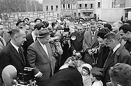 Mrs Khrushchev kisses little girl who is presenting flowers to President Khrushchev in Marseille, France.