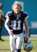 Dallas Cowboys wide receiver Cole Beasley (11) jogs down the sideline to start the second half during the 2015 week 11 regular season NFL football game against the Miami Dolphins on Sunday, Nov. 22, 2015 in Miami Gardens, Fla. The Cowboys won the game 24-14. (©Paul Anthony Spinelli)