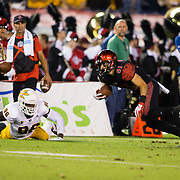 15 September 2018: San Diego State Aztecs wide receiver Ethan Dedeaux (81) breaks a tackle after the catch and darts for the end zone. The Aztecs beat the Sun Devils 28-21 at SDCCU Stadium in San Diego, California.