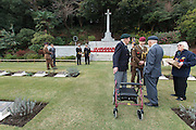 Ex-Japanese prisoner of War, Roy Welland (94) (centre) stalks with members of the Royal British Legion in Japan during the Remembrance Day ceremonies at the Commonwealth War Cemetery in Hodogaya, Yokohama, Japan. Wednesday November 11th 2015